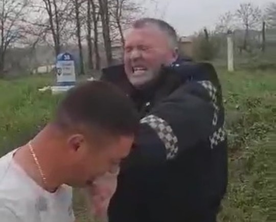 Pic shows: The cop was visibly suffering from the bite REPUBLIC OF MOLDOVA: This is the bizarre moment a suspected drink driver bites the finger of a policeman trying to arrest him and refuses to let go - for eight minutes.
