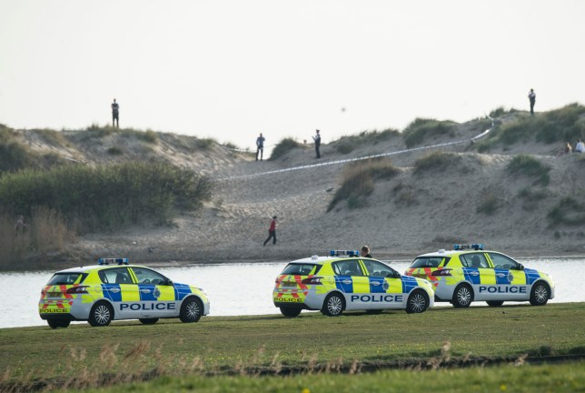 Police cordon in place within the sand dunes near Crosby Marine Lake following reports of a stabbing near the beach in Waterloo, Sefton, Merseyside Credit: Liverpool Echo