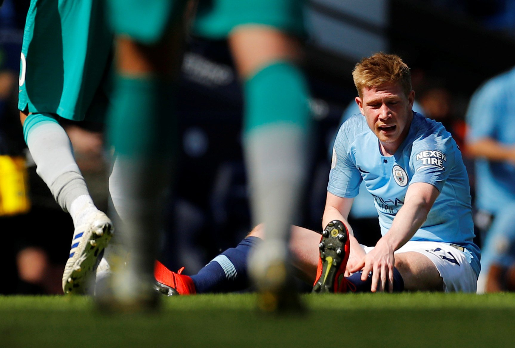 """Soccer Football - Premier League - Manchester City v Tottenham Hotspur - Etihad Stadium, Manchester, Britain - April 20, 2019 Manchester City's Kevin De Bruyne down injured REUTERS/Phil Noble EDITORIAL USE ONLY. No use with unauthorized audio, video, data, fixture lists, club/league logos or """"live"""" services. Online in-match use limited to 75 images, no video emulation. No use in betting, games or single club/league/player publications. Please contact your account representative for further details."""
