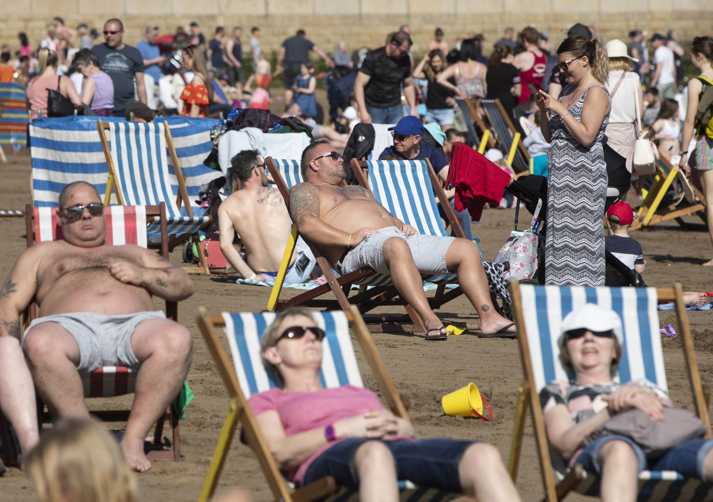 People enjoy the hot weather on Scarborough beach as Britain is set for a sunny Easter bank holiday weekend, that could break national records. PRESS ASSOCIATION Photo. Picture date: Saturday April 20, 2019. See PA story WEATHER Easter. Photo credit should read: Danny Lawson/PA Wire