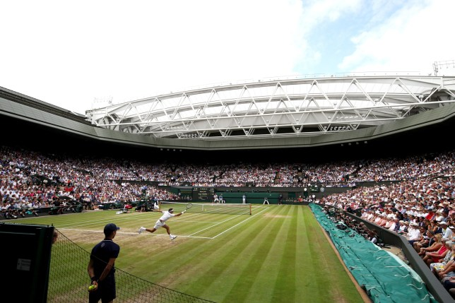 LONDON, ENGLAND - JULY 16: A general view of centre court as Roger Federer of Switzerland plays a forehand during the Gentlemen's Singles final against Marin Cilic of Croatia on day thirteen of the Wimbledon Lawn Tennis Championships at the All England Lawn Tennis and Croquet Club at Wimbledon on July 16, 2017 in London, England. (Photo by Julian Finney/Getty Images)