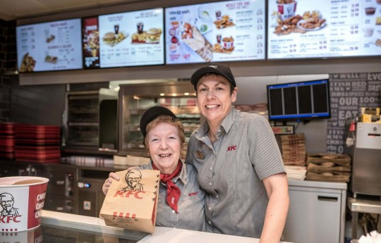 """Pauline Richards with general manager, Alice Yarde. See SWNS story SWBRkfc; A woman has worked at KFC for 41 YEARS serving up over five MILLION drumsticks - and has no plans to retire. Dedicated Pauline Richards, 68, started at the branch in Taunton in Somerset in 1978. She has worked nearly every possible role at the fast food branch including a cleaner, cashier, supervisor, manager and team leader. Because she """"always serves with a smile"""" and has a """"bit of banter"""" with customers at the East Street branch has become a cult hero in the town. The team member revealed children, regular diners, residents and even cricketers would call her """"Miss KFC"""". She said: """"When I go out for a break, children would shout over to me 'Hello Miss KFC' and call me 'Mum' and 'Nan'."""