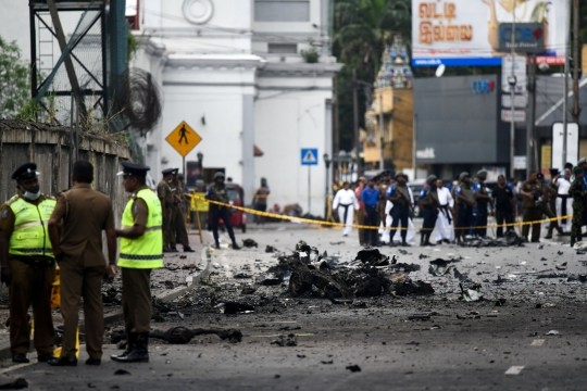 Sri Lankan security personnel inspect the debris of a car after it explodes when police tried to defuse a bomb near St. Anthony's Shrine in Colombo on April 22, 2019, a day after the series of bomb blasts targeting churches and luxury hotels in Sri Lanka. - The death toll from bomb blasts that ripped through churches and luxury hotels in Sri Lanka rose dramatically April 22 to 290 -- including dozens of foreigners -- as police announced new arrests over the country's worst attacks for more than a decade. (Photo by Jewel SAMAD / AFP)JEWEL SAMAD/AFP/Getty Images