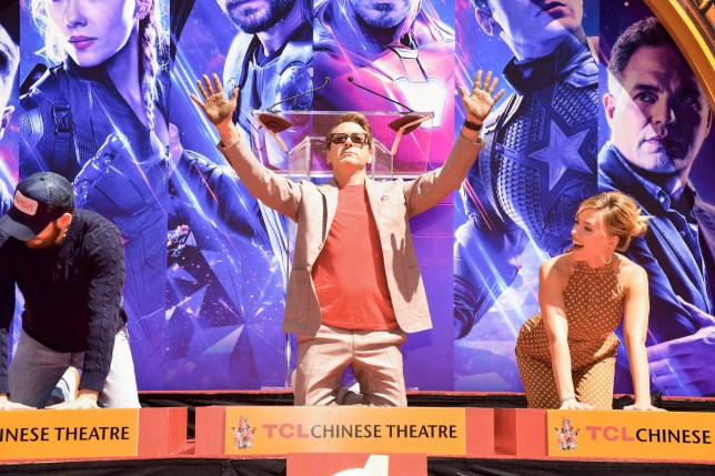 HOLLYWOOD, CALIFORNIA - APRIL 23: Chris Evans, Robert Downey Jr. and Scarlett Johansson pose at the Marvel Studios' 'Avengers: Endgame' Cast Place Their Hand Prints In Cement At TCL Chinese Theatre IMAX Forecourt at TCL Chinese Theatre IMAX on April 23, 2019 in Hollywood, California. (Photo by Matt Winkelmeyer/Getty Images)