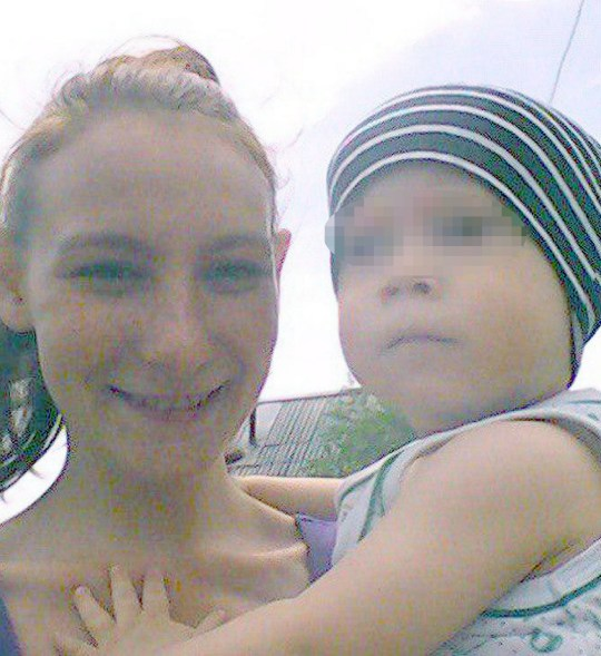 Little boy's mother Irina, 22 - with her son-victim