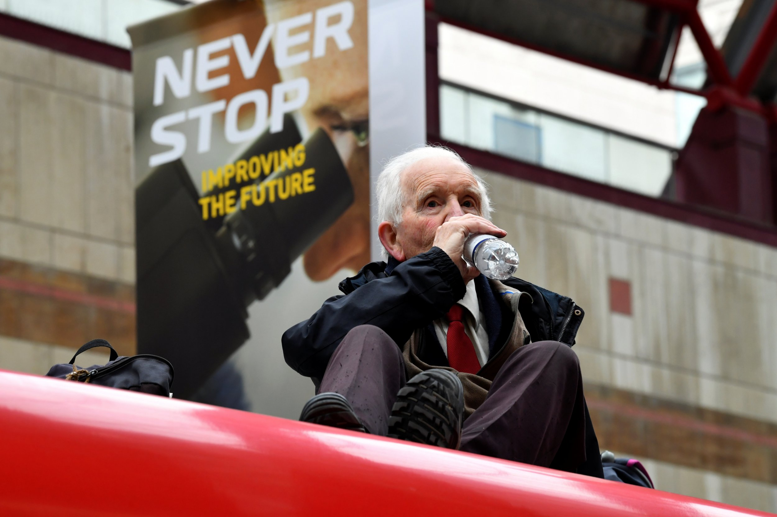 Phil Kingston, 83, sits on top of a DLR train as demonstrators block traffic at Canary Wharf Station during the Extinction Rebellion protest in London, Britain April 25, 2019. REUTERS/Dylan Martinez