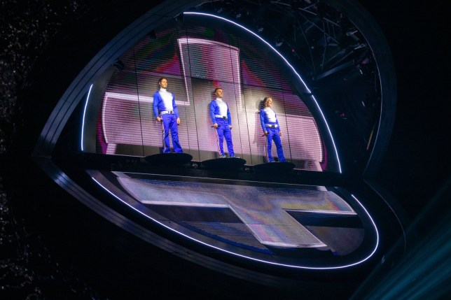 Picture supplied by Bav Media 07976 880732. Picture shows Gary Barlow (centre) of Take That in concert in Sheffield having to keep his eyes closed at the start of the concert because he suffers from vertigo. (L-R Howard Donald,Gary Barlow and Mark Owen) New pictures show Take That singer Gary Barlow closing his eyes at the start of the concert on the bands Greatest Hits tour - because he has vertigo. The singer has admitted his fear of heights means he can't open his eyes when the band appears in a giant floating orb for the opening number, Greatest Day. Photos taken at the start of the concert show the star singing in the orb with his eyes closed because he can't look down at the audience, while his band mates, Mark Owen and Howard Donald, can be seen grinning and waving at their fans. Gary said it took him a week to pluck up the courage to even get in the 35-metre diameter orb, which looks like the image on the front of their latest Odyssey album. He has promised fans that a some point during the tour he will open his eyes. SEE COPY CATCHLINE Gary Barlow VERTIGO pics