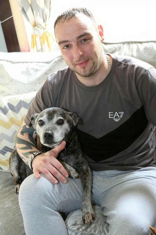 Jonathan Hyslop with rescue dog Lita. See SWNS story SWSClines. A kind-hearted couple adopted an elderly dog found tethered outside a vet surgery and took her in - only to discover she has cancer, and are trying to fundraise her treatment.Shirley Findlay, 33, and her partner Jonathan Hyslop rescued Lita, a Staffordshire Bull Terrier, but are now trying to fundraise ?1,500 to pay for medical treatment for the ageing pooch.They heard of her plight on a Facebook page and approached police for permission to adopt Lita, who they said has brightened up their lives.Lita was found tied up with rope outside Abbey Vets in Murdieston Street, Greenock, Inverclyde.