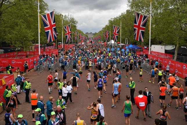 Runners recover after running the 2019 London Marathon
