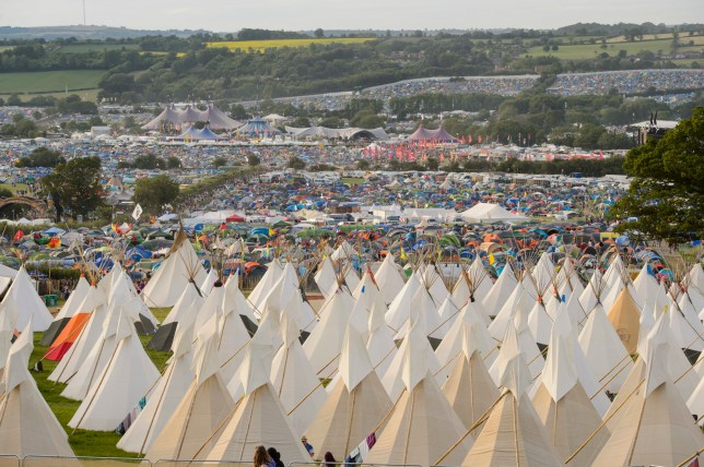 Atmosphere as the sun sets at the Glastonbury Festival at Worthy Farm in Somerset.