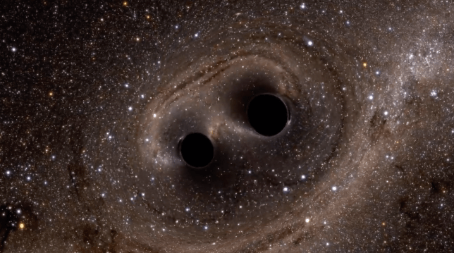 A computer simulation of two black holes merging together (Image: Nasa)