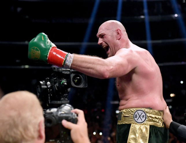 LOS ANGELES, CA - DECEMBER 01: Tyson Fury celebrates at the end of the 12th round fighting to a draw with Deontay Wilder during the WBC Heavyweight Championship at Staples Center on December 1, 2018 in Los Angeles, California. (Photo by Harry How/Getty Images)