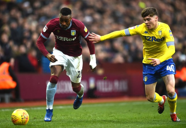 BIRMINGHAM, ENGLAND - DECEMBER 23: Albert Adomah of Aston Villa and Leif Davis of Leeds United in action during the Sky Bet Championship match between Aston Villa and Leeds United at Villa Park on December 23, 2018 in Birmingham, England. (Photo by Nathan Stirk/Getty Images)