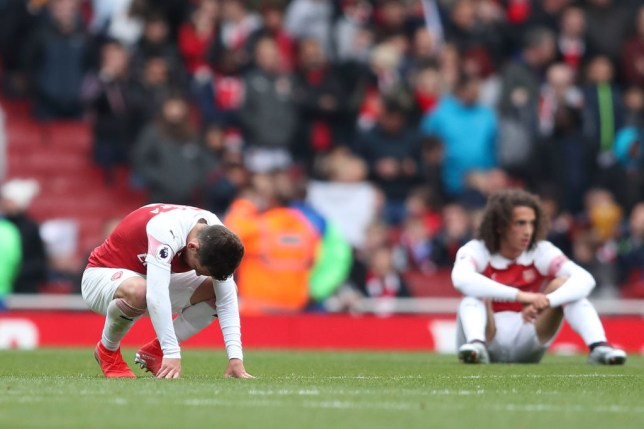 LONDON, ENGLAND - MAY 05: A dejected Lucas Torreira of Arsenal at full time of the Premier League match between Arsenal FC and Brighton & Hove Albion at Emirates Stadium on May 5, 2019 in London, United Kingdom. (Photo by James Williamson - AMA/Getty Images)