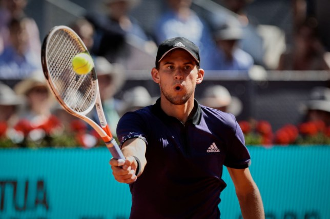 Dominic Thiem hits a forehand volley