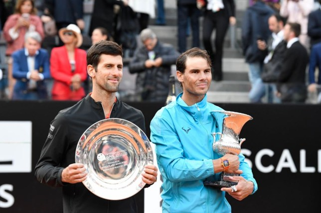 Novak Djokovic stood next to Rafael Nadal with their Italian Open trophies