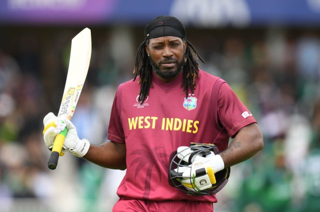 West Indies' Chris Gayle walks off after losing his wicket off the bowling of Pakistan's Mohammad Amir for 50 during the 2019 Cricket World Cup