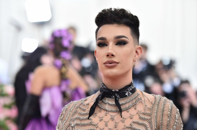 James Charles, a YouTube star, poses at this year's MET gala in a chainmail-inspired top and a black neckerchief