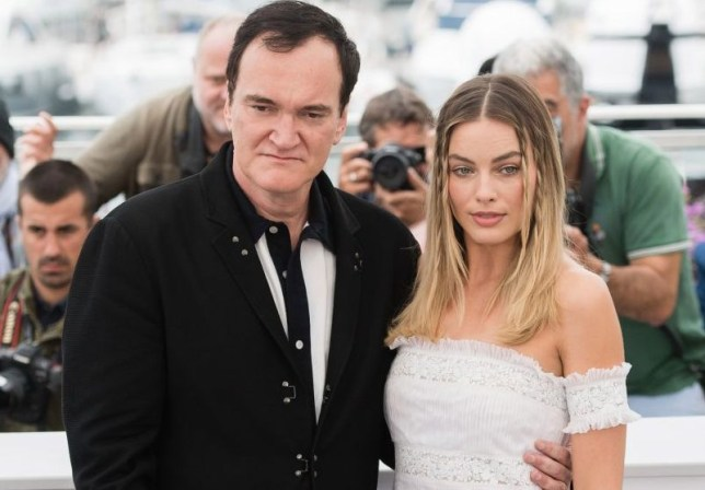 Quentin Tarantino and Margot Robbie attend the photocall for Once Upon A Time In Hollywood at Cannes Film Festival