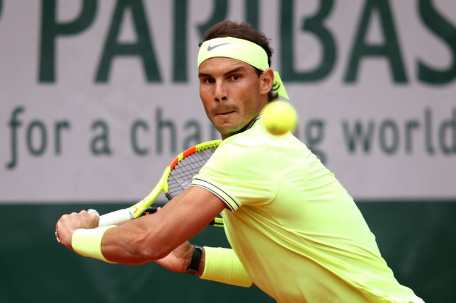 Rafael Nadal hits a backhand during his first French Open match