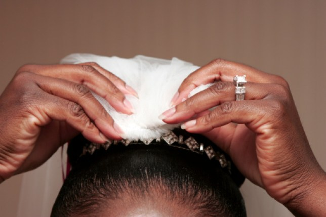 Woman pins veil into her hair