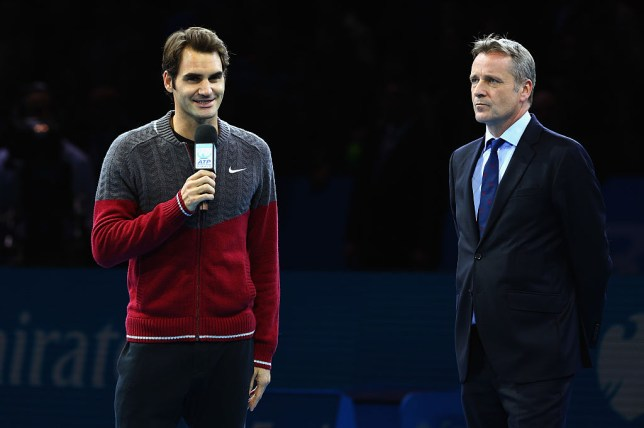 Roger Federer with ATP president Chris Kermode