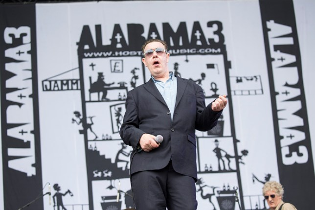 Jake Black from Alabama 3 performs at the Isle Of Wight Festival