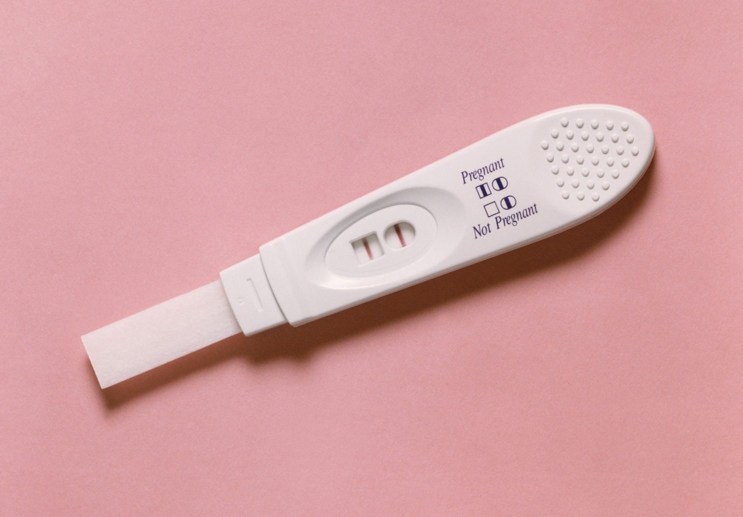 Bride with fertility issues slams guest for giving her a pregnancy test and onesies as a wedding gift