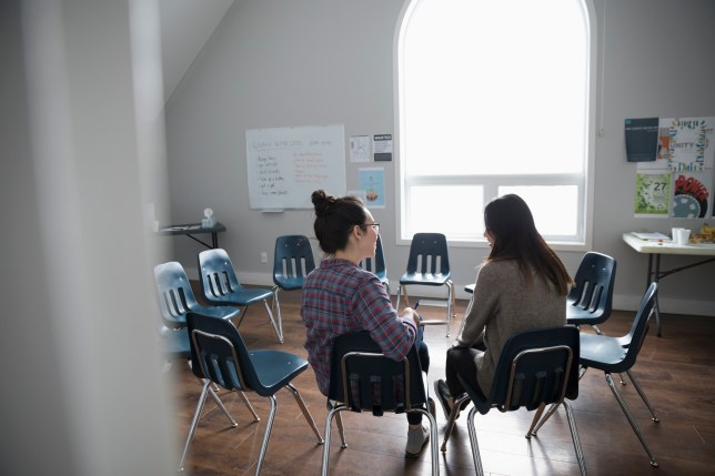 Two women sit in a counselling support group