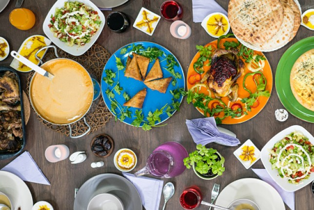 Table of Iftar food ready for family and friends top view for breaking fast during Ramadan