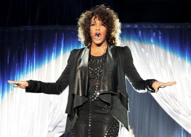 Whitney Houston performing on stage in all black outfit