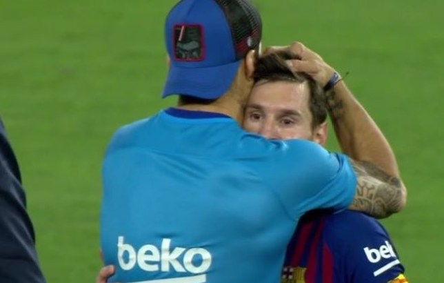 Luis Suarez consoled Lionel Messi after Barcelona's defeat to Valencia in the Copa del Rey final