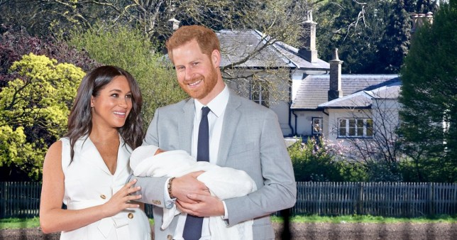 Meghan Markle and Prince Harry holding the royal baby in front of Frogmore Cottage