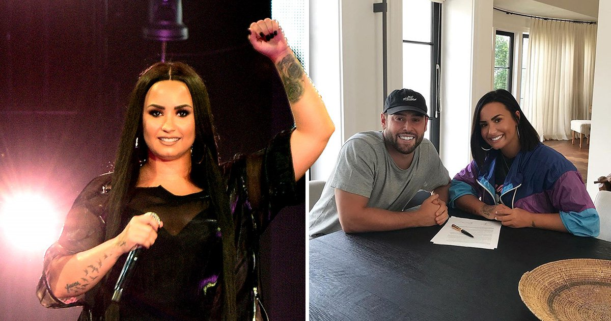 Demi Lovato pictured with Scooter Braun after signing to his mangement label SB Projects