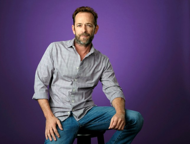 """FILE - In this Aug. 6, 2018, file photo, Luke Perry poses for a portrait during the 2018 Television Critics Association Summer Press Tour in Beverly Hills, Calif. A publicist for Perry says the """"Riverdale"""" and """"Beverly Hills, 90210"""" star has died. He was 52. Publicist Arnold Robinson said that Perry died Monday, March 4, 2019, after suffering a massive stroke. (Photo by Chris Pizzello/Invision/AP, File)"""