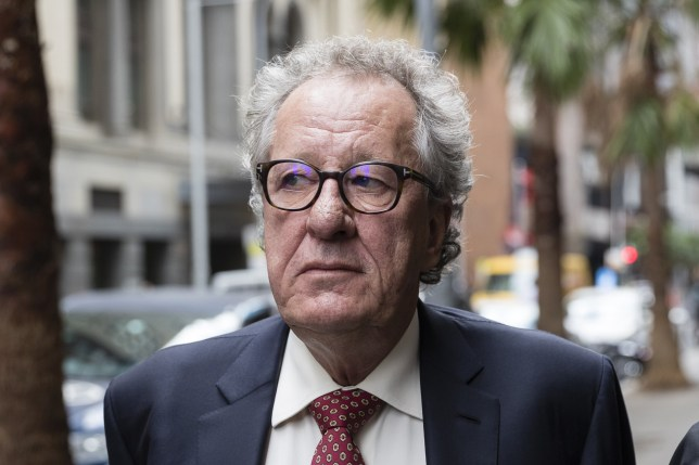 SYDNEY, AUSTRALIA - APRIL 11: Geoffrey Rush (c) arrives at the Supreme Court of New South Wales on April 11, 2019 in Sydney, Australia. The three-week trial concluded in November 2018, with Justice Michael Wigney to deliver his verdict early next year. Geoffrey Rush is suing The Daily Telegraph for defamation over a series of articles that were published in late November and early December 2017 that alleged he behaved inappropriate during a 2015 stage production of King Lear. (Photo by Brook Mitchell/Getty Images)