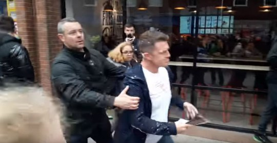 Tommy Robinson gets a milkshake thrown at him Picture: paul ryder
