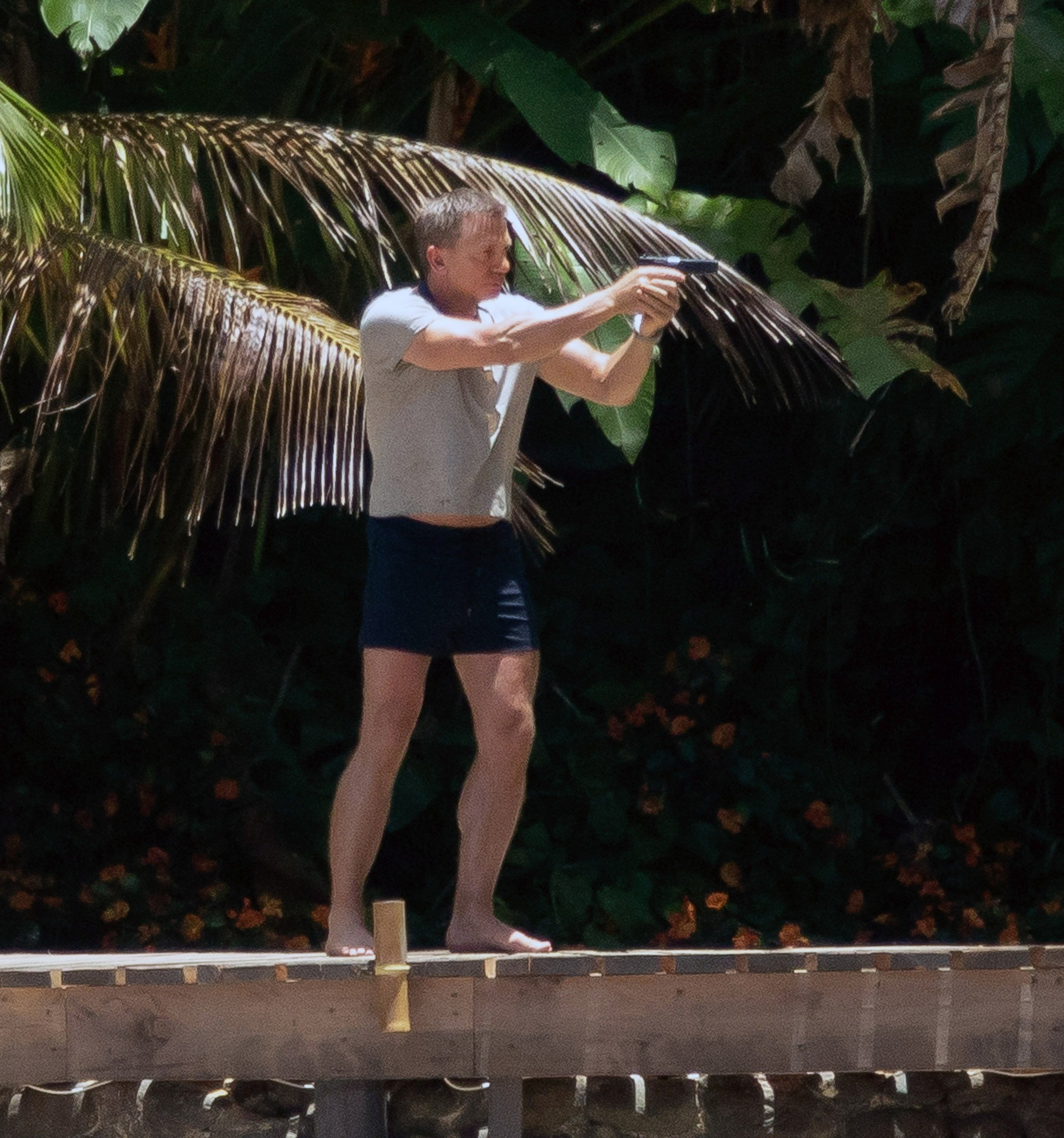 EXCLUSIVE: *Online Embargo Midnight Sunday 5th May 2019 BST / MIN ??500 set fee online / print (double front page)* Daniel Craig films the latest scenes on the set of the new James Bond movie in Jamaica. He was spotted on a boardwalk at a specially built beachfront house set in lush tropical surroundings. In one scene, Daniel Craig goes fishing with a spear gun as Bond appears to have caught his own dinner during a boat trip. Craig was seen wielding a large spear gun and then carrying two large fish from his sailing boat along the dock. Daniel Craig can also be seen smoking a cigar during a break in filming on the set for the new James Bond movie in Jamaica. After the scenes he took a stroll on his own along the beach as two police patrol boats made sure he was safe, staying by the set all day. Pictured: Daniel Craig Ref: SPL5084881 010519 EXCLUSIVE Picture by: SplashNews.com *Online Embargo Midnight Sunday 5th May 2019 BST / MIN ??500 set fee online / print (double front page)* Splash News and Pictures Los Angeles: 310-821-2666 New York: 212-619-2666 London: 0207 644 7656 Milan: 02 4399 8577 photodesk@splashnews.com World Rights