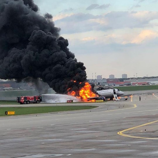 Image result for At least one dead as plane erupts into flames during an emergency landing in Moscow