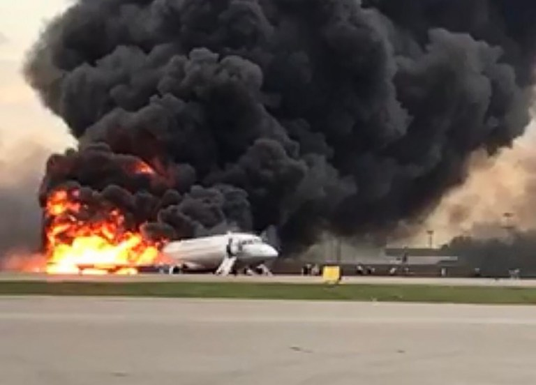 """This handout picture taken and realeased on May 5, 2019, by the Investigative Committee of Russia shows a fire of a Russian-made Superjet-100 at Sheremetyevo airport outside Moscow. - The Interfax agency reported that the plane, a Russian-made Superjet-100, had just taken off from Sheremetyevo airport on a domestic route when the crew issued a distress signal. At least one person is died according to Russian agencies. (Photo by HO / RUSSIAN INVESTIGATIVE COMMITTEE / AFP) / RESTRICTED TO EDITORIAL USE - MANDATORY CREDIT """"AFP PHOTO / RUSSIAN INVESTIGATIVE COMMITTEE"""" - NO MARKETING NO ADVERTISING CAMPAIGNS - DISTRIBUTED AS A SERVICE TO CLIENTSHO/AFP/Getty Images"""