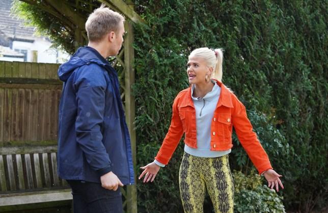 Ewan (Riley Jones) warns Lola (Danielle Harold) that Ben Mitchell (Max Bowden) is dangerous