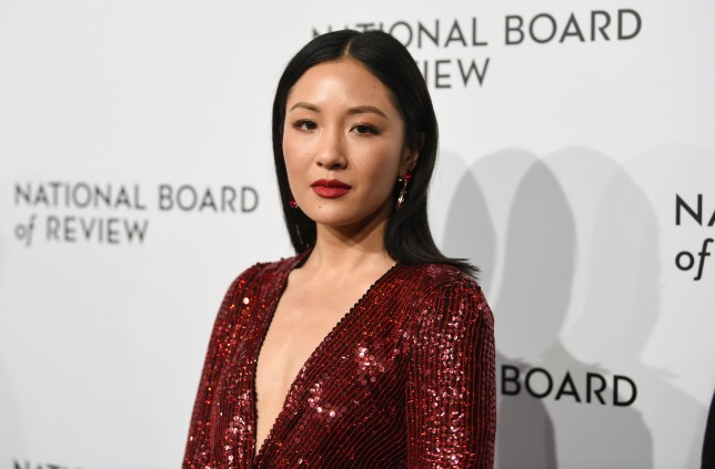 Actress Constance Wu pictured at the National Billboard of Review in a sequined red dress