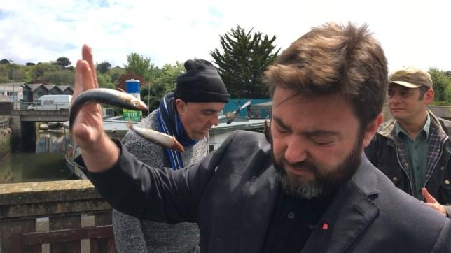 Fish thrown at UKIP European Parliamentary candidate Carl Benjamin during trip to Truro