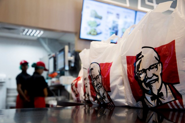 KFC in bags at a restaurant counter