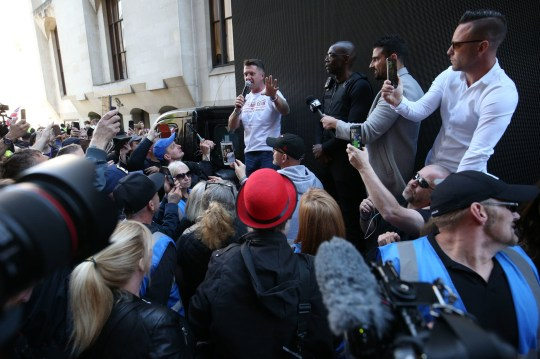 Tommy Robinson speaks to supporters after leaving the Old Bailey in the City of London, ahead of the latest stage of a case against the former EDL leader over an allegation he committed contempt of court. PRESS ASSOCIATION Photo. Picture date: Tuesday May 14, 2019. See PA story COURTS Robinson. Photo credit should read: Jonathan Brady/PA Wire