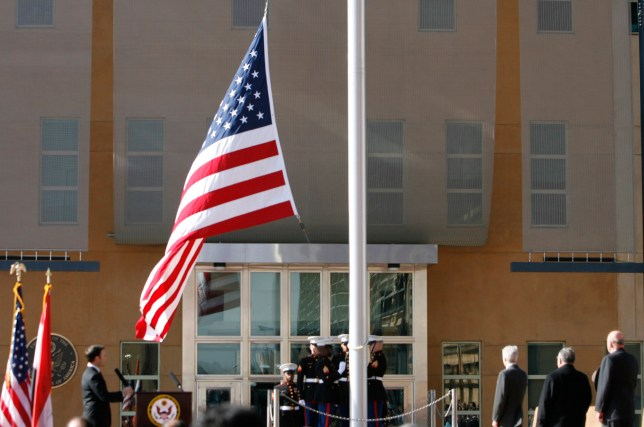 BAGHDAD, IRAQ - JANUARY 5: The US flag is raised during a formal dedication ceremony attended by the Iraqi President Jalal Talabani, at the new US embassy amid heavy security, in Green Zone, on January 5, 2009 in Baghdad, Iraq. The embassy compound is the biggest and most expensive that the US have built and will house 4000 staff. (Photo by Getty Images)