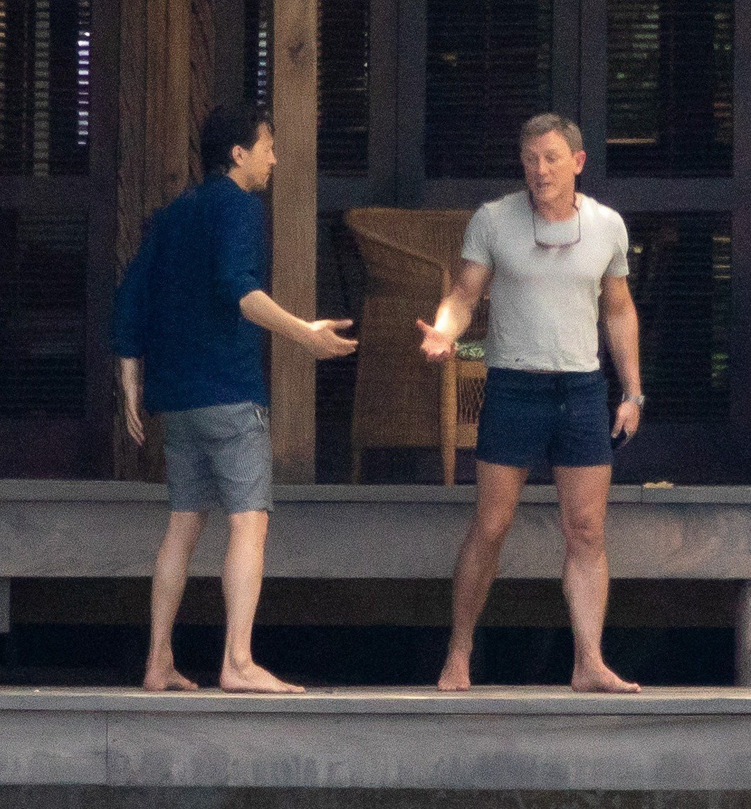 Daniel Craig has a exhilarated contention during a mangle in filming with executive Cary Joji Fukunaga on a set of new Bond film in Jamaica