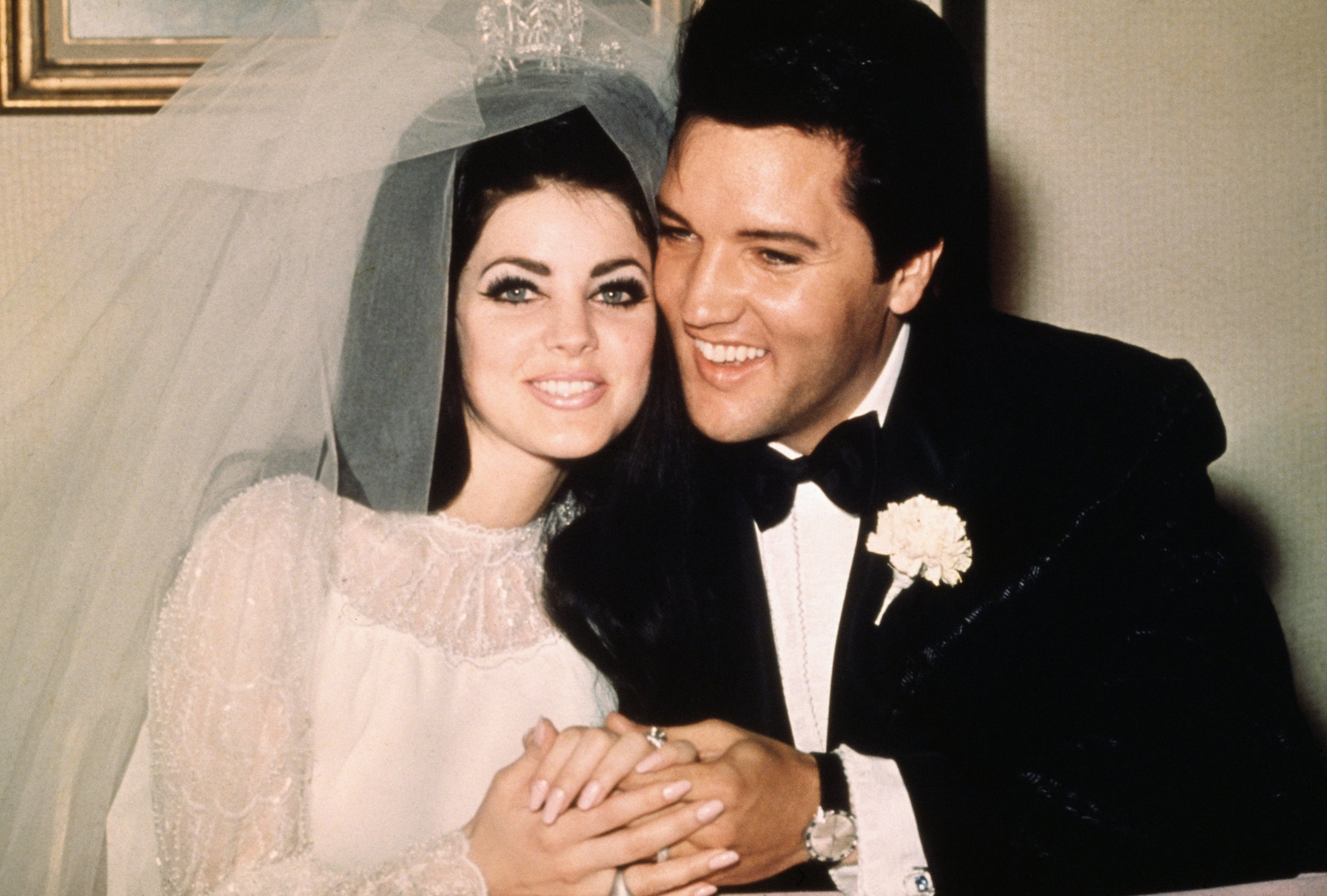(Original Caption) Las Vegas, Nev..Entertainer, Elvis Presley sits cheek to cheek wit his bride, the former Priscilla Ann Beaulieu, following their wedding May 1, 1967.