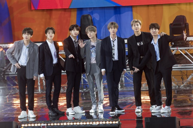 """NEW YORK, NY - MAY 15: (L-R) Kim Tae-hyung, Park Ji-min, Jungkook, Suga, Kim Seok-jin, RM and J-Hope of BTS perform on """"Good Morning America's Summer Concert Series"""" from Rumsey Playfield in Central Park on May 15, 2019 in New York City. (Photo by Debra L Rothenberg/FilmMagic)"""
