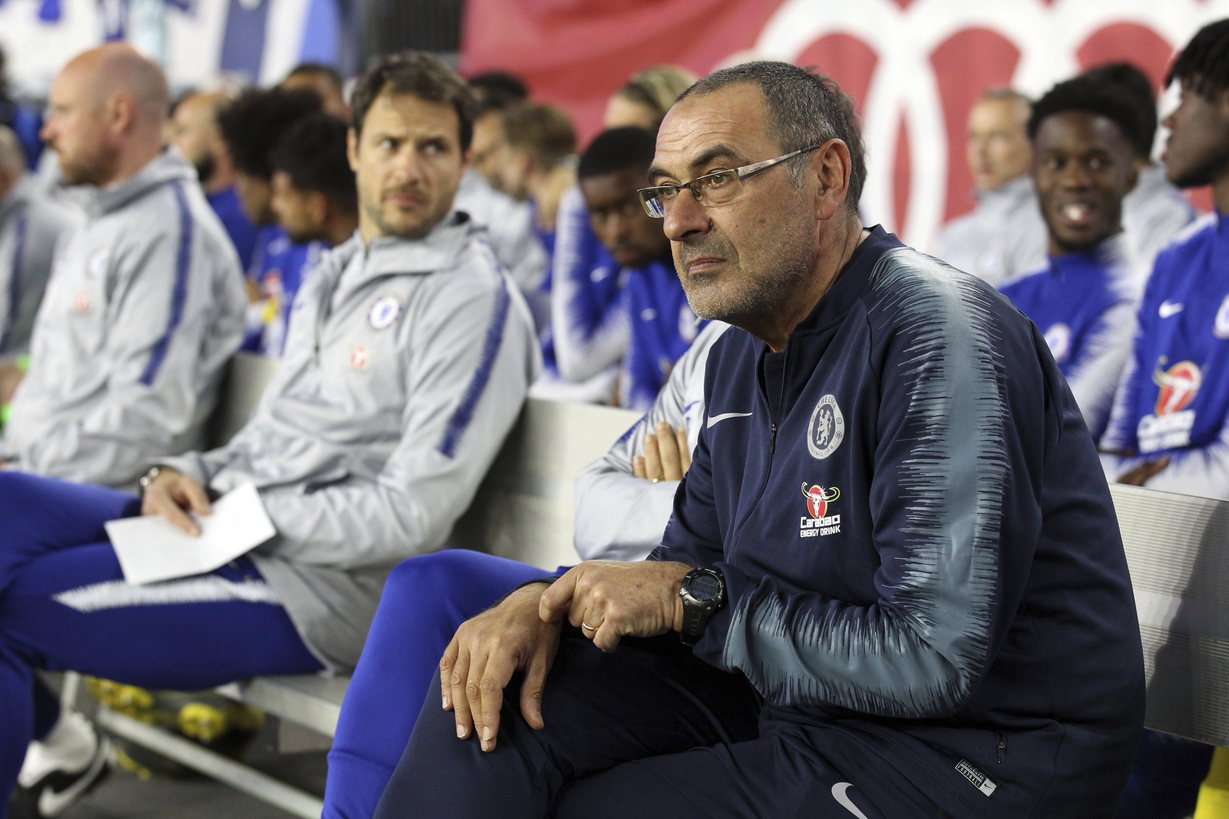 Chelsea head coach Maurizio Sarri watches from the bench during the first half of a friendly soccer match against the New England Revolution, Wednesday, May 15, 2019, in Foxborough, Mass. (AP Photo/Stew Milne)